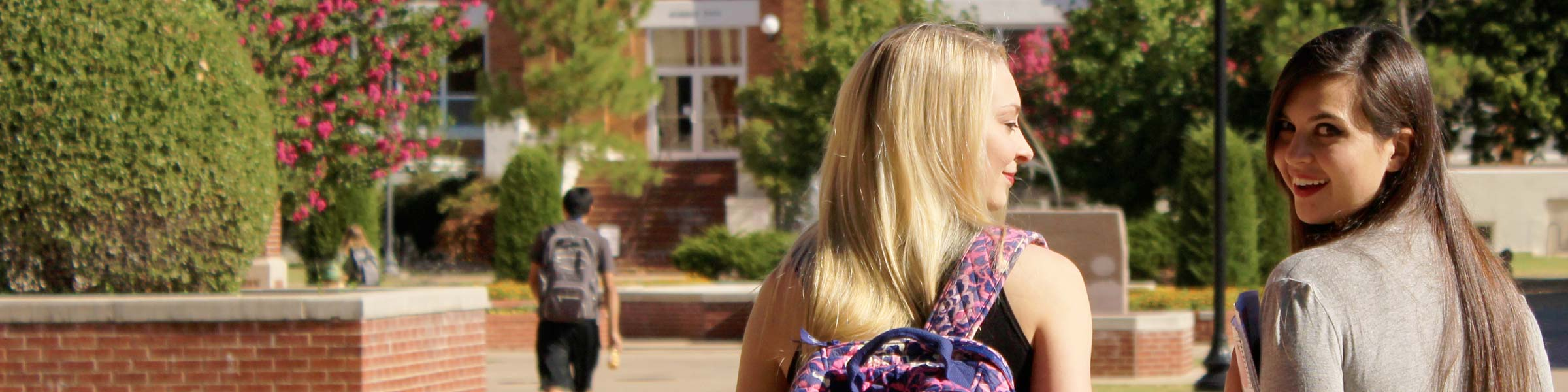 students walking on plaza