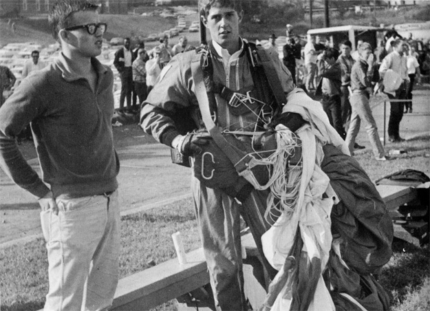 Richard Wallrather gives an exciting exhibition of sky-diving during half-time at the 1967 homecoming game.