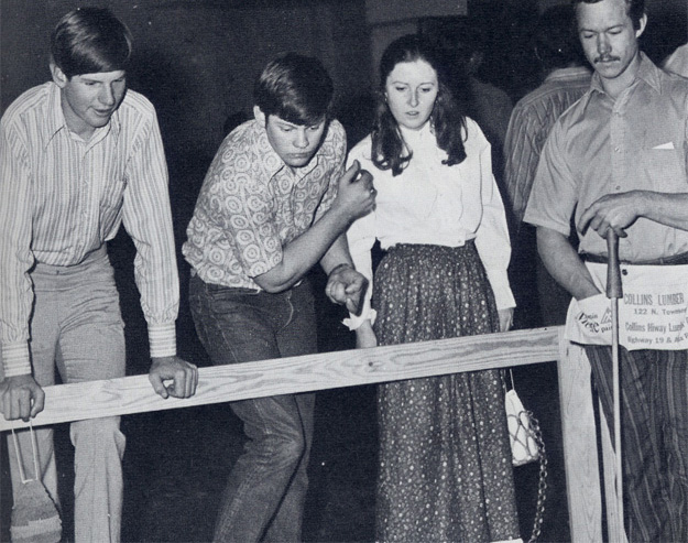 "Spring Carnival 1972: ""Industrial Arts lures crowd with Lady Luck at the penny pitch booth."""