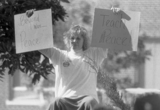 a woman protests the Gulf War during Military Awareness Day
