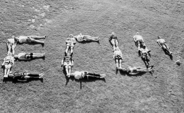 """Members of the Student Senate work together to spell out their favorite university."""