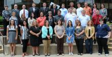 Group photo of ECU's new faculty for 2013-14
