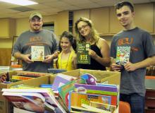 Photo of Alpha Chi Volunteers with donated books