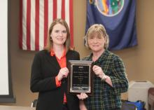 Stacey Bolin, left, and Charlee Lanis hold the Exceptional Program Award for Best Conference in the Great Plains Region of the Association for Continuing Higher Education.
