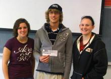 Photo of students with check