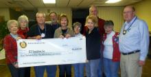 Photo of sunrise rotary club with the donation check.