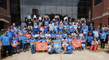 Photo of students gathering around to show their support for the OKC Thunder