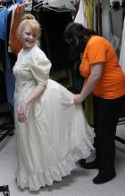 "Emelia Robinson, who plays Grandma Tzeitel, is fitted for a dress by costume designer Raegan Thomas in preparation for East Central University's 2016 production of ""Fiddler on the Roof."" The production is set for March 3-5 at 7:30 p.m. each night in the Ataloa Theatre of the Hallie Brown Ford Fine Arts Center."