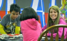 photo of Lacie Lawson with boys and girls club members.