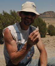 Mark Micozzi with theropod tooth