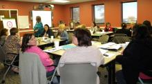 Participants in the Train the Trainer workshop held at the Johnston-Douglas Building by the Chickasaw Nation Child Development Center listen to one of the speakers present data they can use later in their own trainings.