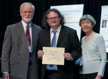 Professor Phil Todd receiving award.
