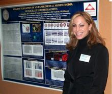Dr. Raniyah Ramadan, who died last July, is shown with a poster explaining her research