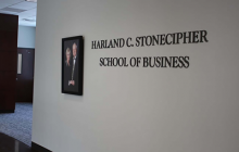 The sign to the entrance of the Harland C. Stonecipher School of Business