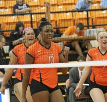 Attached are action shots of Tatiana Booth playing volleyball at East Central University