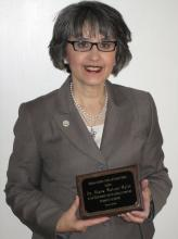 Photo of Dr. Diana Watson-Maile with her award.