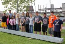 Willard students posing by beam