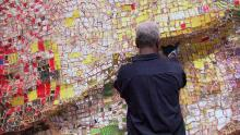 Ghanaian sculpture El Anatsui works on one of his pieces.