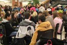 Students gathered in chairs for interscholastic meet