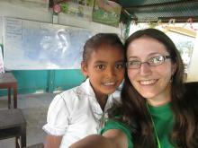 East Central University student Linzi Thompson poses with a young girl in Cambodia during her trip in December.