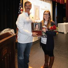 Noelle Hurt-Bryan presented with Ada District Junior High Teacher of the Year Award from Principal Ronny Johns.