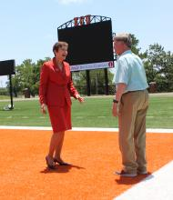 President Pierson, Crabtree view new scoreboard.