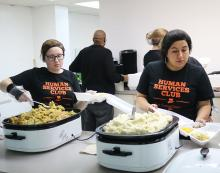 ECU Human Services Club serves at the annual Community Thanksgiving Dinner.