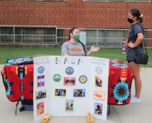 A student visits the Native American Student Association booth at the ECU Block Party that traditionally kicks off the fall semester. A new comparative study has recognized ECU as one of the most affordable institutions of higher learning in the country in terms of low student loan debt.