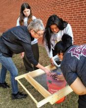 Dr. Holly Jones teaches East Central University students archeological flotation techniques in this pre-Covid file photo.